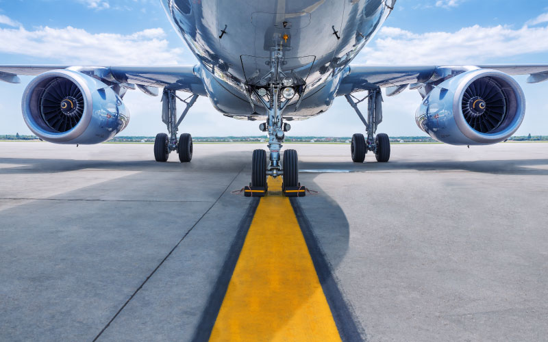 Air freight plane on runway with yellow runway line